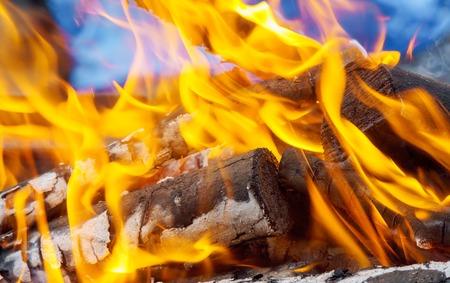 three burning billets in hot stove wood fire heat Stok Fotoğraf