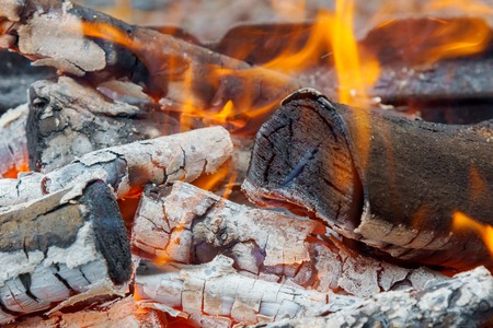 three burning billets in hot stove wood fire heat Stock Photo