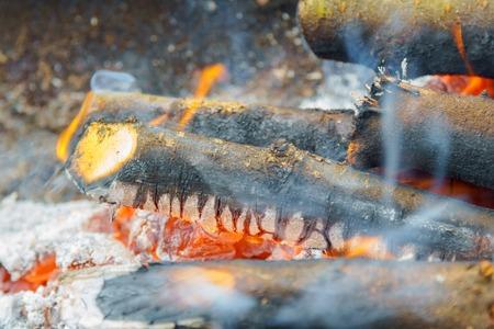 smolder: three burning billets in hot stove wood fire heat Stock Photo