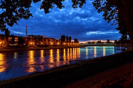 street lamp: Beautiful reflection of lanterns in the river in the city uzgorod Ukraine.