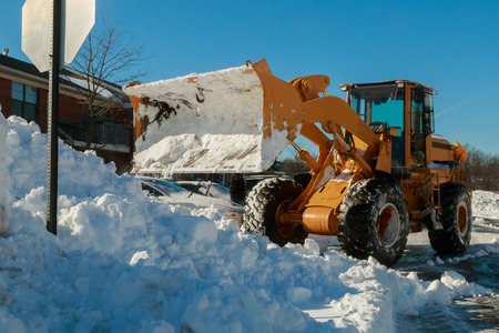 Snow removal vehicle removing snow snow tractor snow removal Stock Photo