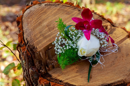Wedding bouquet of pink peonies, white hydrangea and light blue flowers with light blue ribbons and wedding accessories: brides bracelet and pearl hair clip and grooms boutonniere