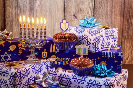 jewish holiday Hanukkah with menorah, wooden dreidels Hanukkah candles celebration Archivio Fotografico