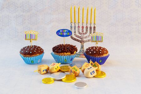 hannukah: Jewish holiday hannukah symbols - menorah, donuts, chocolate coins and wooden dreidels jewish holiday Hanukkah with menorah Stock Photo