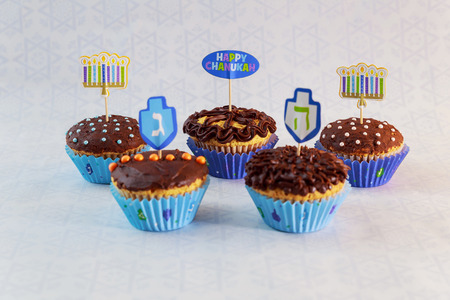 Jewish holiday Hanukkah cupcakes Gourmet cupcakes decorated with white and blue icing for Hanukkah.