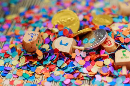 hebrew script: Jewish holiday Dreidel and the small oil jug that last for eight days. Stock Photo