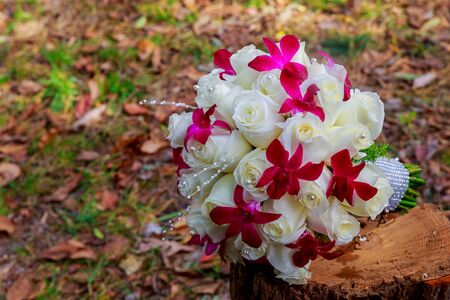 position d amour: image of wedding bouquet , Wedding bouquet of pink and white roses lying on grass