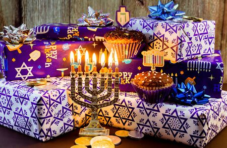 Jewish holiday hanukkah celebration with vintage menorah tallit