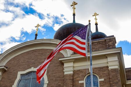 church steeple: God Bless America American flag and old church steeple reflect separation of church and state