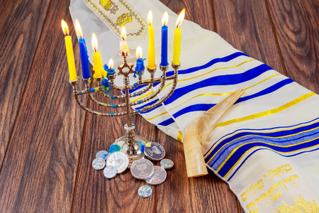judaical: jewish holiday Hanukkah with menorah over wooden table Star of David Hanukkah menorah Hanukkah candles