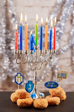 hanukka: Jewish holiday Image of jewish holiday Hanukkah background with menorah traditional candelabra and burning candles