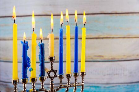 hanukka: Jewish holiday hannukah low key image of jewish holiday Hanukkah with menorah traditional Candelabra and wooden dreidels spinning top . glitter overlay