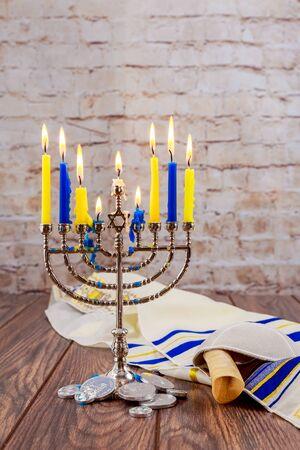 hanukka: jewish holiday Hanukkah with menorah over wooden background Hanukkah menorah candles Jewish holidays