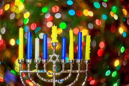 hanukka: jewish holiday Hanukkah background with menorah traditional candelabra and burning candles Hanukkah Menorah candles