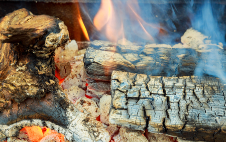 Closeup of firewood burning in fire three burning billets in hot stove Stok Fotoğraf