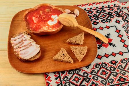 Borsch Ukrainian ethnic food Ukrainian beetroot soup - borscht in bowl with salted fresh lard - salo, garlic,