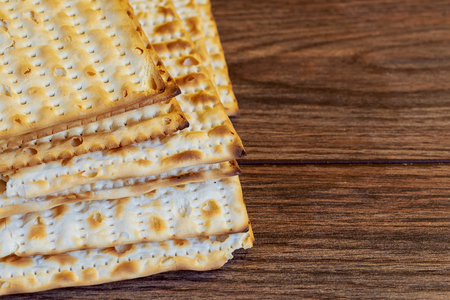 jewish products, jewish food, Holiday symbol, Jewish Holiday symbol Matzoh for jewish holiday Passover pesah on wooden background. View from above Stock Photo