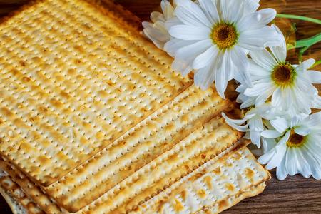 pesakh: Jewish Holiday symbol, jewish food passover jewish passover food Pesach matzoh white gerbera Stock Photo