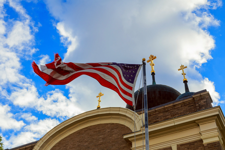 American flag and old church steeple reflect separation of church and state Stok Fotoğraf