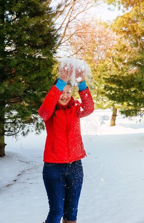 happy shopper: Attractive young woman in snowy winter park beautiful girl walking in winter