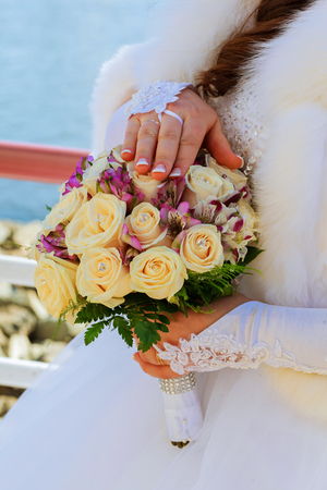 the bride holding wedding bouquet of pink and white roses Stock Photo