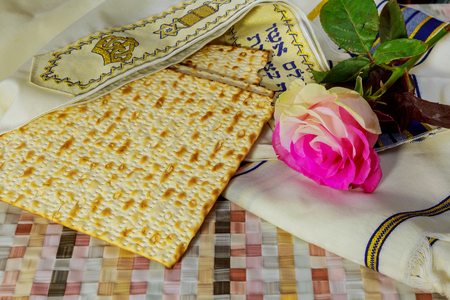 Rose passover Jewish holidays jewish matzo bread on a table with flowers Jewish holiday, Holiday symbol, Zdjęcie Seryjne