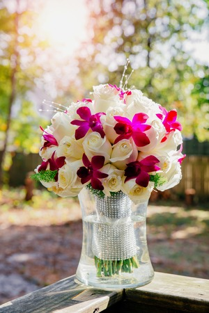 Wedding bouquet with roses on a wooden bench Wedding bouquet of roses