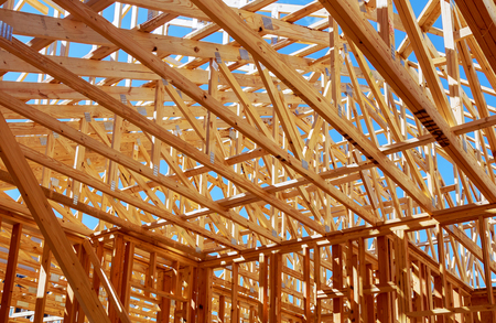 Wood framing on new house under construction 스톡 콘텐츠