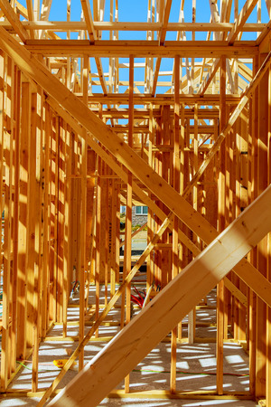 Wood framing on a new house under construction Stock Photo