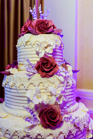 Wedding cake with roses Delicious white wedding cake decorated with pink cream roses