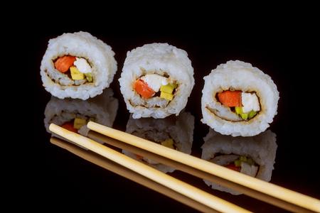 Maki sushi over black background close up of sashimi sush Stock Photo