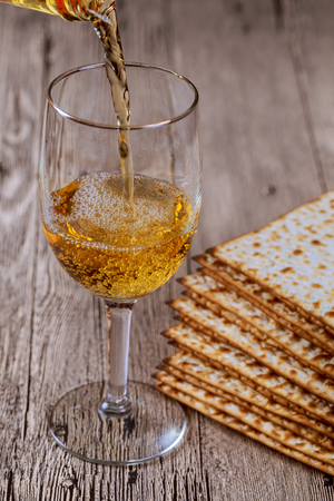 matzah: Matzo for Passover and wine on table close up Stock Photo