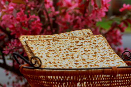 passover background. wine and matzoh jewish holiday bread on wooden table