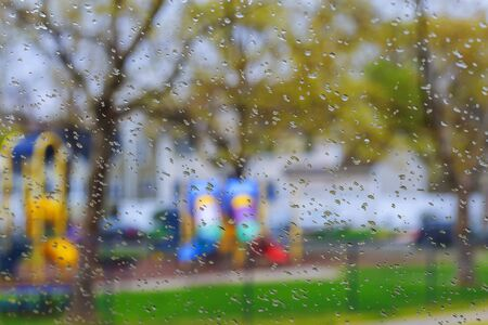 rain drop on window glass with blur tree background raindrops on glass