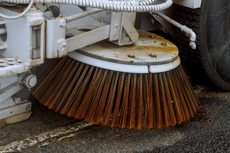 Close up road sweeper machine cleaning city street Cleaning streets 写真素材