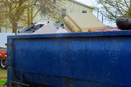 container Over flowing Dumpsters being full with garbage