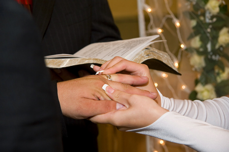 Wedding rings exchange wedding ring on brides finger Stock Photo