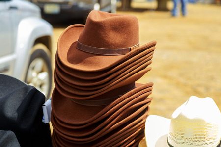 mens hats of felt for sale at a flea market, selected focus and narrow depth of field
