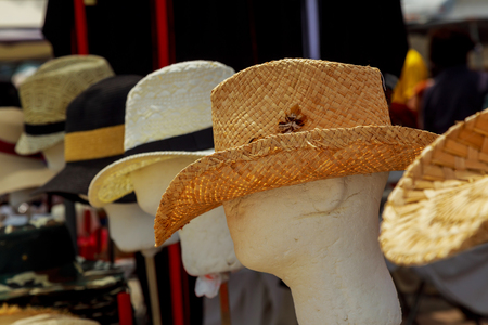 Summer hats display sale in a street market. Stock Photo