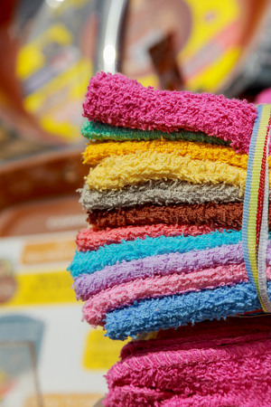 Group of colorful towels for sale on the street market