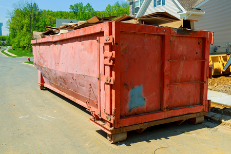 disposed: Dumpsters being full with garbage in a city. Dumpsters being full with garbage Stock Photo