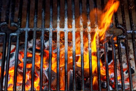 Top View Of Empty And Clean Barbecue Charcoal Grill With Flames Of Fire, Close Up Stock Photo