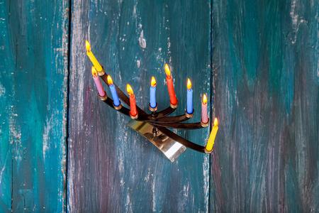 hanukka: Jewish Holiday Hanukkah background with menorah wood dreidel tradition Stock Photo