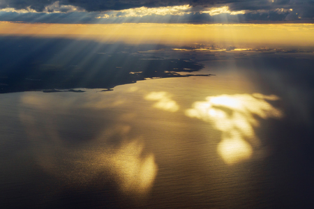 Morning sunrise view from an airplane flying over the ocean, the image to add text or a website frame. traveling concept