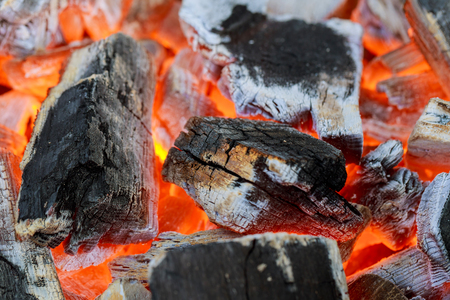 combustible: Wood burning in the fireplace closeup. Home Warm orange bonfire with pieces wood Stock Photo