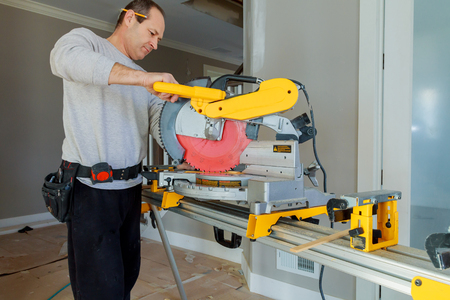 build buzz: worker cuts board on circular saws man cutting wood on electric saw