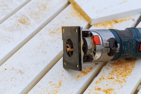 metalic: variable speed plunge router isolated on sawdust background