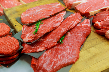 meat products in in small butcher shop steaks in stores