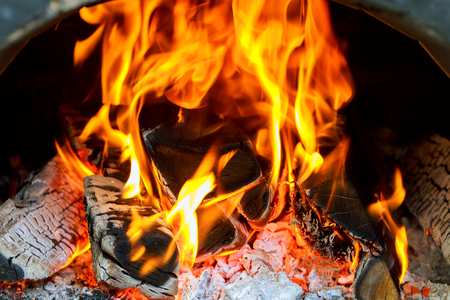 Closeup of firewood burning in Fireplace fire wood