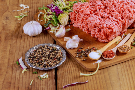 veal sausage: minced beef, onion, garlic black pepper ready for cooking wood table Stock Photo